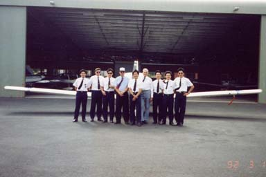 Photo of myself and my fellow Cathay Pacific Airlines Cadet Pilots taken in front of a G.R.O.B. light aeroplane.