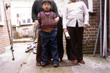 Photo of myself, my Mother and two Brothers taken in the backyard of our house in Ipswich. Photo taken by my Father who didn't frame the shot very well so that only my head is showing. Circa 1976